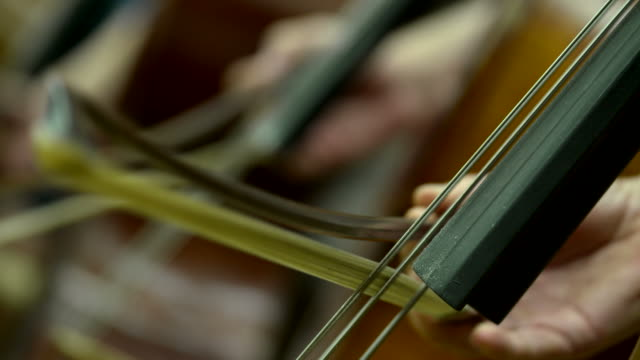bow on a cello string in orchestra - orchestra stock videos & royalty-free footage
