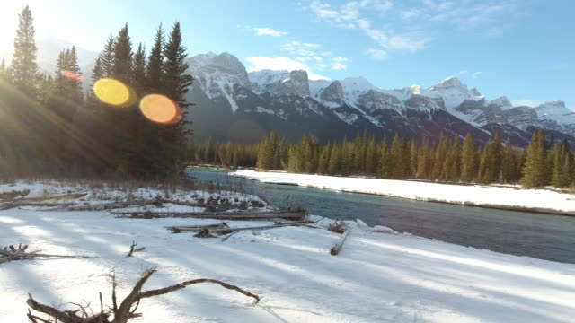 bow river aerial winter 3 - snowcapped mountain stock videos & royalty-free footage