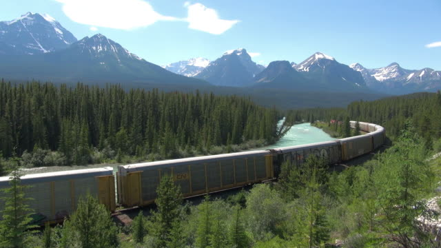 MS Bow River and cargo train at morants curve / Banff National park, Alberta, Canada