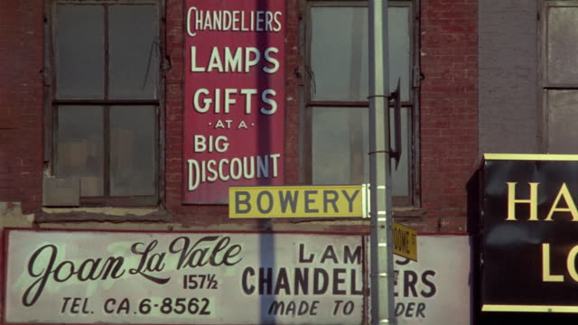 1969 ms bowery street sign, lamp store signs, new york city, new york, usa - store sign stock videos & royalty-free footage