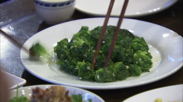 cu bowl of cooked broccoli being eaten, beijing, china - bowl stock videos and b-roll footage