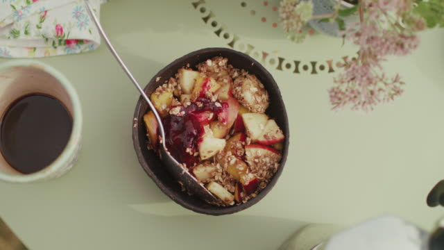 bowl of granola in beautiful bowl on table with flowers and coffee - strength stock videos & royalty-free footage