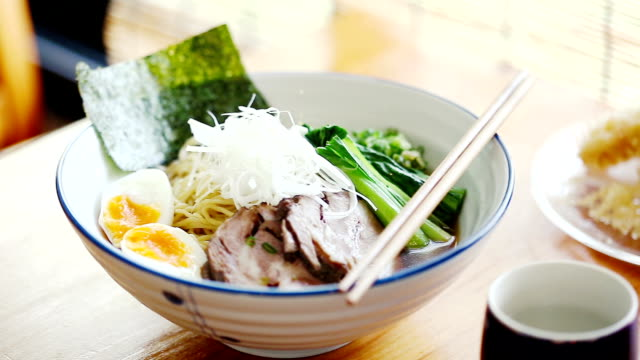 bowl of hot ramen or noodles soup in japan - ramen noodles stock videos & royalty-free footage