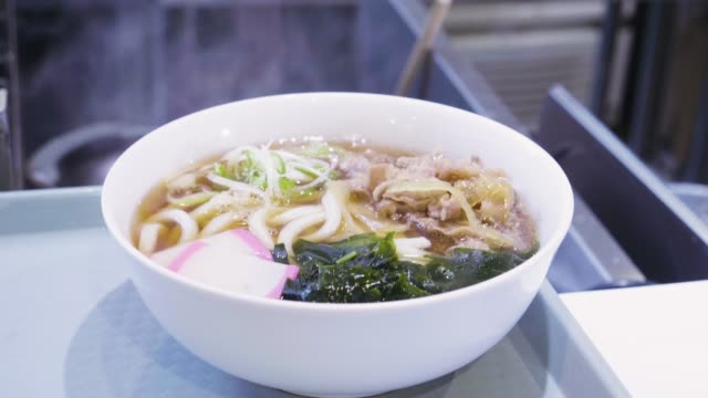 bowl of hot ramen or noodles soup in thailand - ramen noodles stock videos & royalty-free footage