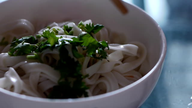 bowl of noodles. - cilantro stock videos and b-roll footage