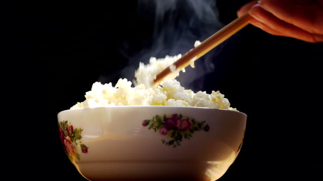 bowl of rice with hot. - rice plant stock videos and b-roll footage