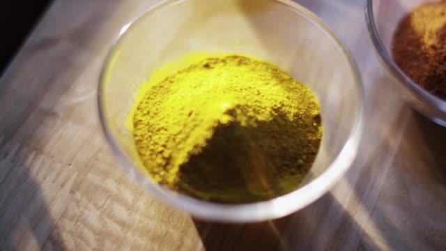 a bowl of turmeric powder - seasoning stock videos & royalty-free footage