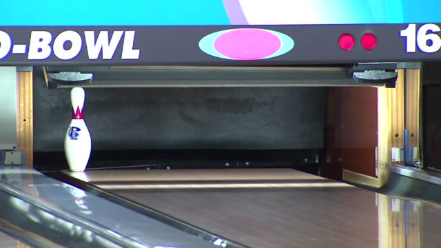 bowling at globowl fun center where andrew cowen is practicing to bowl a perfect 300 game while bowling backwards on april 15 2014 in marengo il - ボーリングボール点の映像素材/bロール
