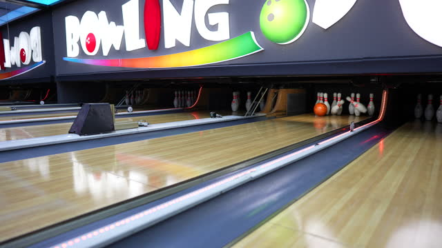 bowling ball and skittles on the playing field - impact stock videos & royalty-free footage