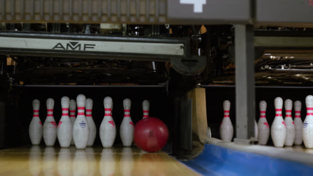 ms zi bowling ball in gutter of lane next to bowling pins - bowling ball stock videos & royalty-free footage