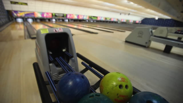 cu bowling ball returning to rack / dover, new hampshire, usa - medium group of objects stock videos & royalty-free footage
