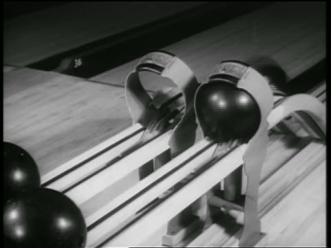 b/w 1938 2 bowling balls rolling up in ball return of bowling alley / chicago / newsreel - bowling ball stock videos & royalty-free footage