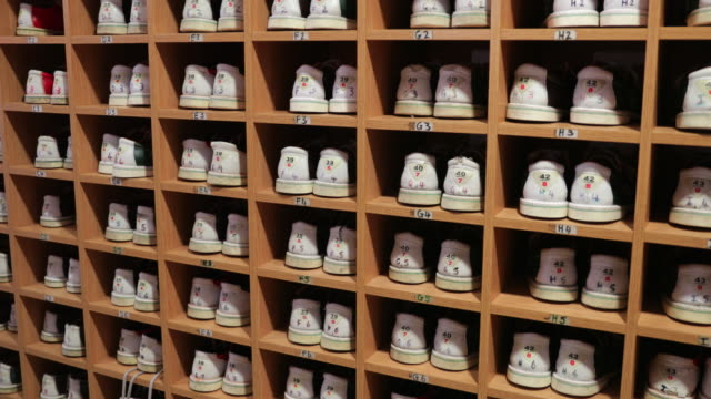 bowling shoes on a rack - large group of objects stock videos & royalty-free footage