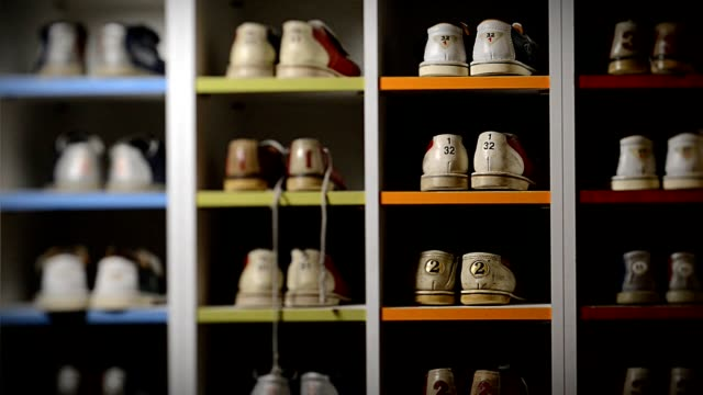 bowling shoes, on pair is taken out of the rack - collection stock videos & royalty-free footage