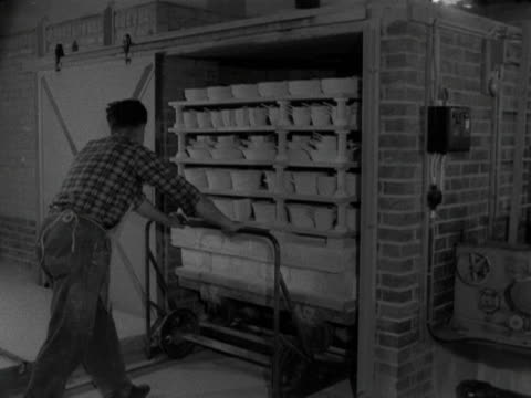 bowls and dishes are placed into a large kiln at the stavanger pottery workshop 1959 - kiln stock videos and b-roll footage