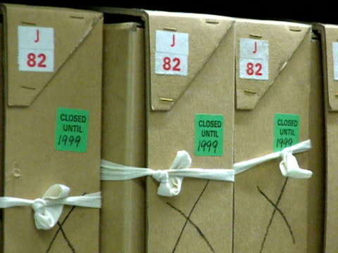 stockvideo's en b-roll-footage met box file in a public records office, marked 'closed until 1999'; 1999 - bbc archives