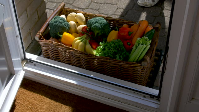 box of fruit and vegetables being delivered to house. - delivering stock videos & royalty-free footage