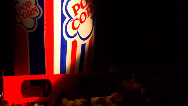 box of popcorn with 3d glasses rotating on surface - mpeg video format stock videos & royalty-free footage