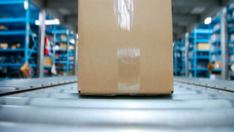 stockvideo's en b-roll-footage met box on a conveyor belt - distribution warehouse