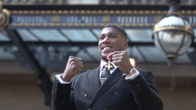 boxer anthony joshua receives his obe from the prince of wales during an investiture ceremony at buckingham palace - order of the british empire stock videos and b-roll footage