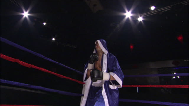 LA MS TU TD Boxer boxing freestyle and wearing robe in ring / Jacksonville, Florida, USA