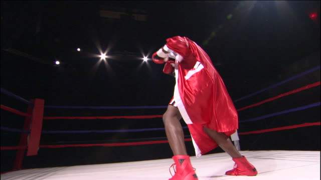 la ws boxer boxing freestyle and wearing robe in ring / jacksonville, florida, usa - boxing ring stock videos and b-roll footage