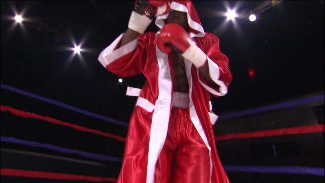 CU TU LA MS Boxer boxing freestyle and wearing robe in ring / Jacksonville, Florida, USA