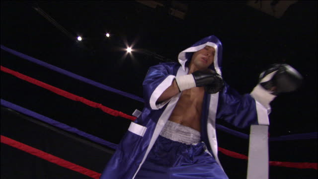LA MS Boxer boxing freestyle and wearing robe in ring / Jacksonville, Florida, USA