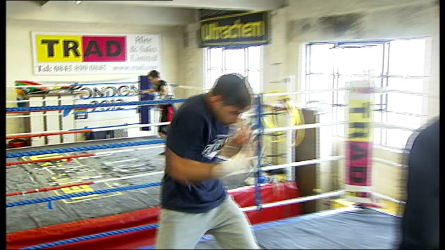 Boxer Frank Buglioni interview Buglioni shadow boxing PULL OUT Reporter to camera