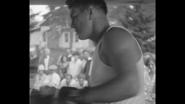 boxer gene tunney displays impressive footwork skips rope and pummels the heavy leather punching bag / the training enclosure with a lake beyond with... - enclosure stock videos and b-roll footage