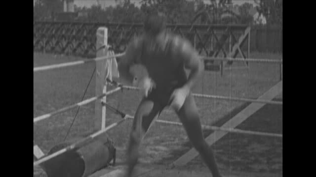 boxer jack dempsey shadow boxing / dempsey in ring sparring / challenger billy miske smiling / [note: film has nitrate deterioration] - sports training stock videos & royalty-free footage