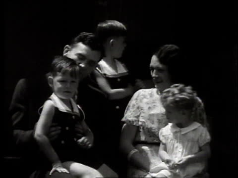 montage boxer jim braddock sitting with his family / chicago illinois united states - 1937 stock videos and b-roll footage