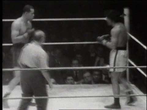 vídeos de stock e filmes b-roll de boxer joe louis boxing and knocking out pat valentino / united states - 1949