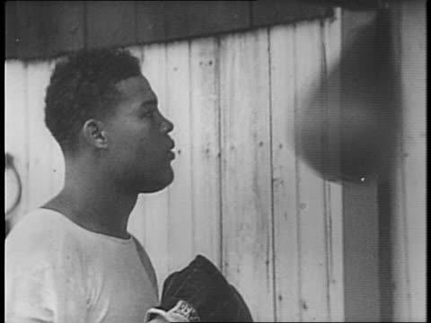 boxer joe louis jumping rope punching a punching bag / training for nova bout / louis talks about joining the army / louis marches with a rifle /... - uncle sam stock videos & royalty-free footage
