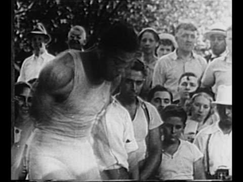 boxer joe louis skips rope as spectators watch in background as he trains in 1937 / cu louis's feet as he jumps rope / louis jumps rope faster /... - lager stock videos & royalty-free footage