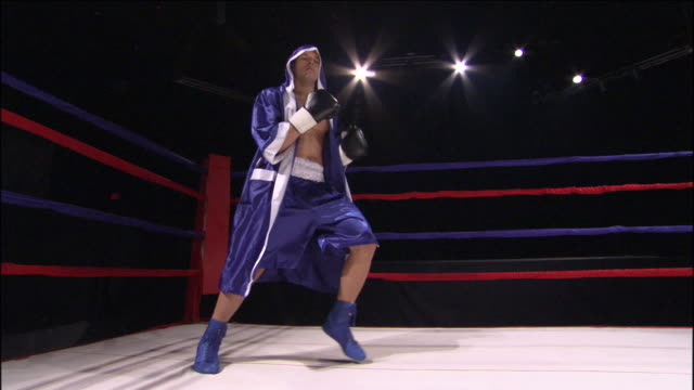 la ws boxer jumping over ropes into ring and boxing freestyle / jacksonville, florida, usa - jacksonville florida stock videos and b-roll footage