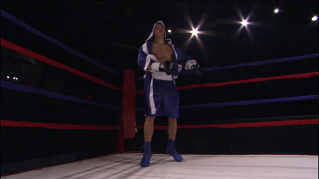 LA WS Boxer jumping over ropes into ring and boxing freestyle / Jacksonville, Florida, USA