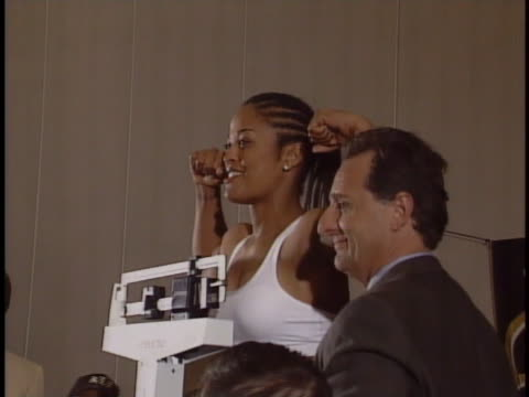 boxer laila ali weighs in at a press conference in syracuse, new york, prior to her boxing match against jacqui frazier-lyde. - 女子ボクシング点の映像素材/bロール