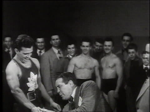 boxer max baer joking with canadian bodybuilders / canada - 1949 stock videos & royalty-free footage