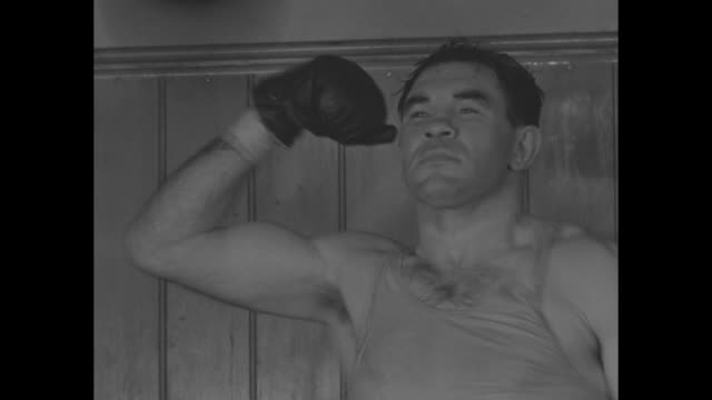 vs boxer paulino uzcudun pummels boxing bag as he prepares for upcoming heavyweight championship fight against primo carnera in rome/ vs skipping... - primo carnera stock videos and b-roll footage