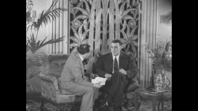 Boxer Primo Carnera at right sits with his manager Louis Soresi in the lobby of the Hotel Victoria in New York City SOT Soresi asks Carnera if he is...