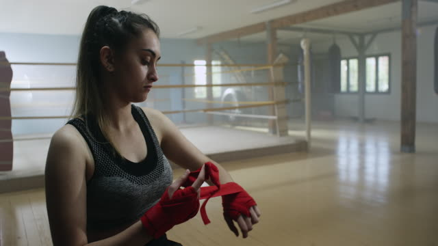 Boxer putting on hand wraps