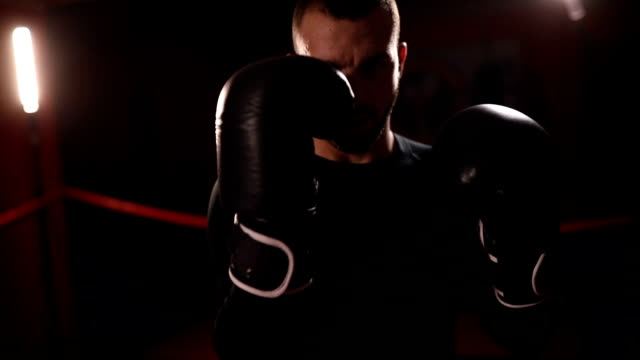 Boxer throwing punches on training
