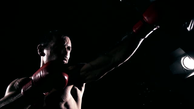 hd super slow mo: boxer training in the club - punch bag stock videos and b-roll footage