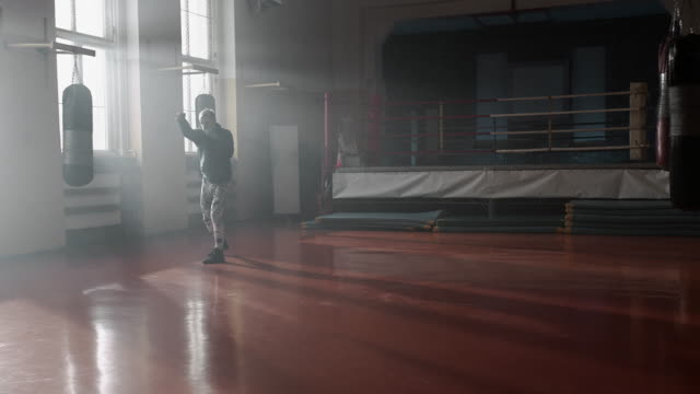 boxer training. shadowboxing. - boxing ring stock videos and b-roll footage