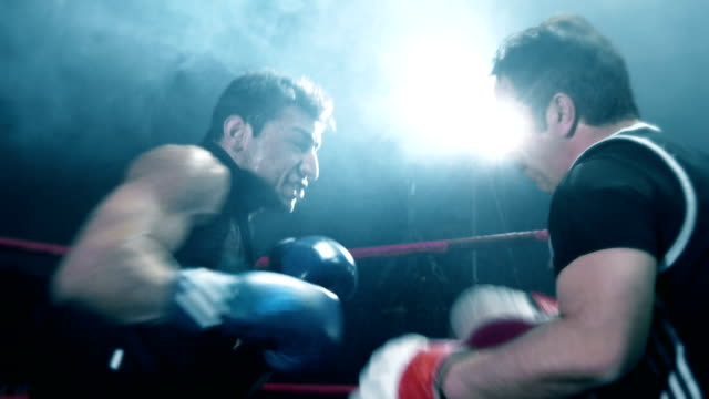 boxer training with his coach - punch bag stock videos & royalty-free footage