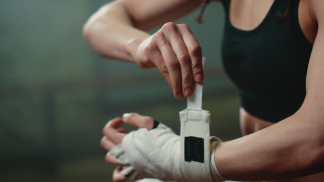 Boxer wrapping bandages around her hand