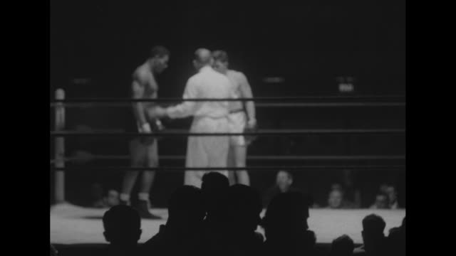 Boxers Bob Bickle Arthur Guglielmelli David Moore Frank Eschevarria in unedited footage of boxing matches winners to represent the US at Helsinki...