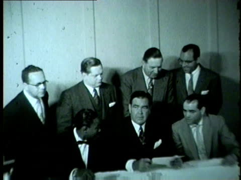 boxers bobo olson kid gavilan sign a contract in chicago in 1954 - 1954 stock videos & royalty-free footage