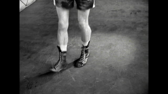 b&w ms of boxer's feet skipping with rope; 1963 - boxing stock videos & royalty-free footage